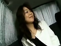 Enticing Japanese lady flashes her lovely fun bags and deep-throats a