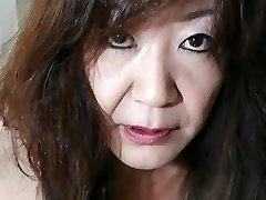 Japanese Grannie flashes Tits and Pussy