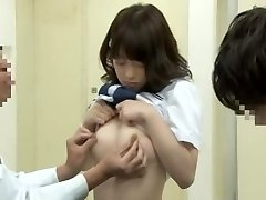 Noisy oriental schoolgirl getting fingered by her doctor on the medical couch