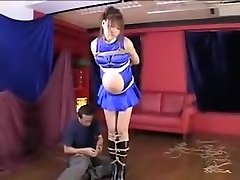 Knocked Up Asian gal is tied up with her stomach hanging out an