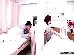 Handsome Japanese nurse gives a patient some partThree