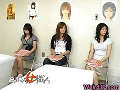 Asian wife is examining chick workers