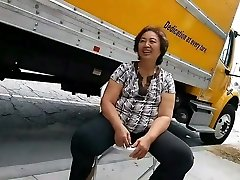 Asian grandmother woman bending over then chatting and smiling