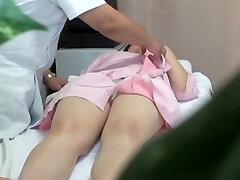 Japanese babe gets fingered during erotic massage session