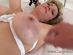 British mature Lady Sonia gagged and roped to the bed