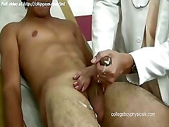 Steaming doctor masturbates cock to boy
