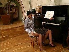 Russian lesbian piano educator