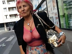 Sexy granny whith see through top in public
