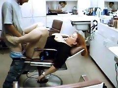 Hairdresser rests on my manstick in the salon