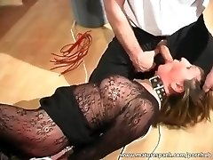Mature bitch gets bound and fucked with faux-cock