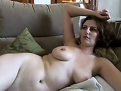 Big-boobed mature brunette with ample boobs and hairy pussy strips