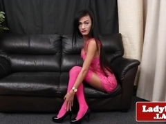 Lingeried ladyboy stretches culo and tugs solo