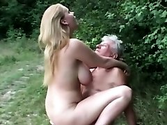 Innate huge boobed slut fucks grandpa in the woods