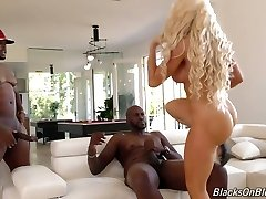 Fake tittied blond milf Nikki Delano is penetrated hard by two ebony fellows