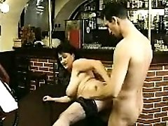 Brunette in stockings bj's large cock and fucks it