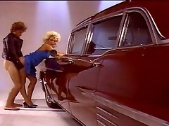 Blonde female romping good by the car