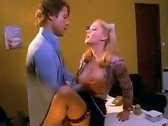 Pretty blonde assistant in stockings fucked on the desk