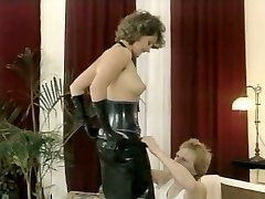 Hussy mistress in spandex outfit gives deepthroat blow-job