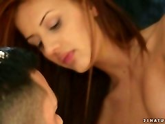 Romantic red haired honey gives footjob to her beau early in the morning