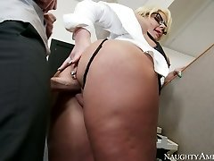 Busty light-haired Phoenix Marie gets her pussy drilled by Johnny Sins