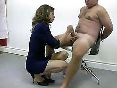 Policewoman tortures naked offender by masturbating and wrecking his orgasm