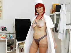 Ugly red haired old cardiologist Milada loosens by polishing her vag