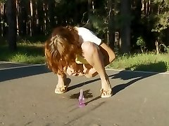 sexy teen pissing on the road in the woods