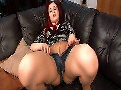 Nikita's tights make her wank her muff on sofa