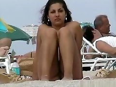 A voyeur capturing pussies and tits of dolls on a bare beach