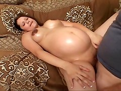 Smoothly-shaven pregnant bitch pulverizing for her luck