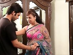 Indian teacher in cool pink boulder-holder and sari seducing young guy
