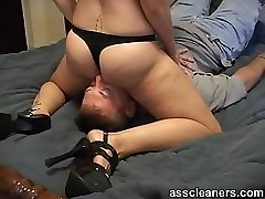 Mistress in high-heeled shoes and bikini sits her uber-cute ass on man's face
