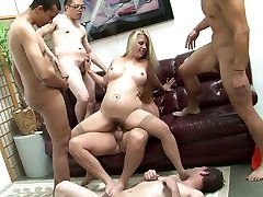 Huge-boobed blonde whore gets penetrated by dicks in all holes