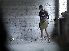 Long skirt woman peeing old place
