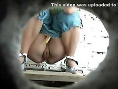 Curvaceous babe pisses in a voyeur video clip