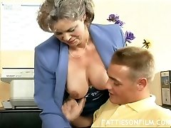 Volutuous grey haired granny Kelly drills her young stud in the office