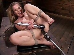 Lilly Lit gets humped by machines in restrain bondage