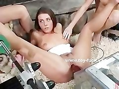 Girl/girl babes playing with huge fucking machines in a hollyday h