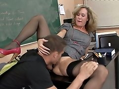 Promiscuous blond teacher pleases her student with a skillful blowjob