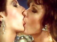 Sharon Mitchell in a lesbian scene in this elder retro vid clip