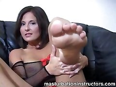 Jerky teacher puts her feet up and demos feet wank skills