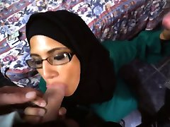 Watch this Nerdy Arab getting dicks in her face!