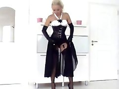 Smoking blonde in corset + heels