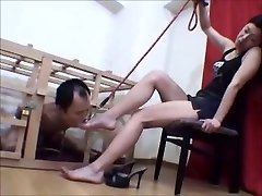 Caged Japanese foot victim worships her dominatrix