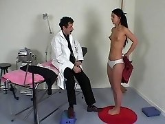 French physician performs a full physical exam