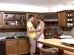 guy pokes warm mature mom in the kitchen