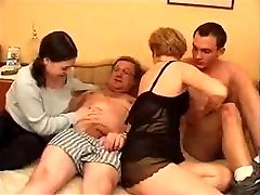 Mature duo with young couple in bed