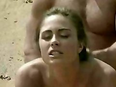 Black-haired getting laid on beach