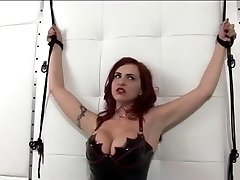Hot red-haired in leather and pointy tits gets ducked by dildo