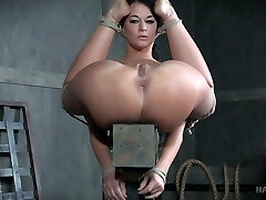 Provocative dark haired London River takes metal hook in her ass fucking hole